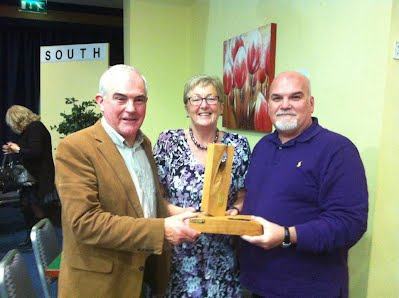 Padraic Gallagher and John McNamara accepting  the winning trophy for the Novice competition.